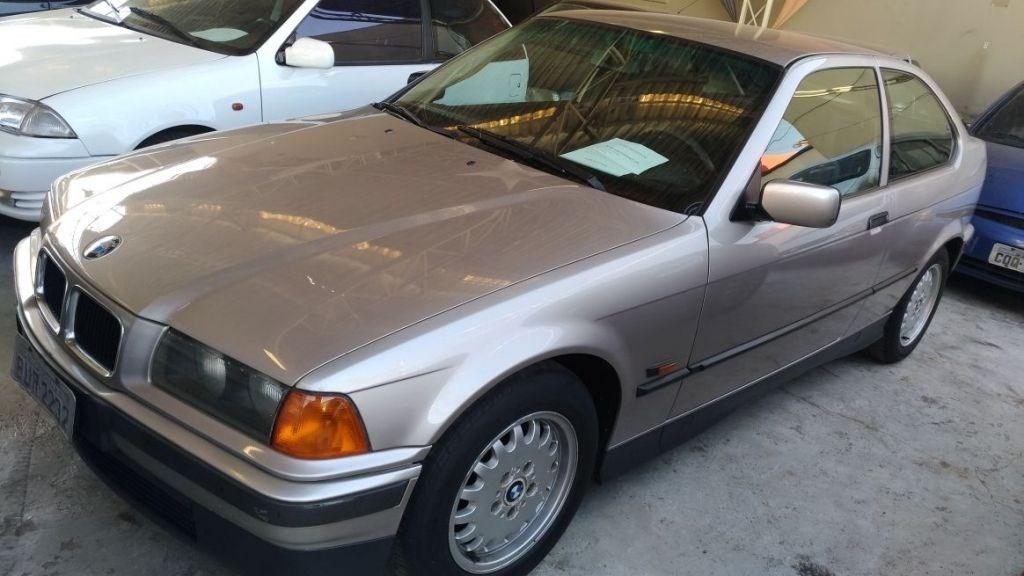 //www.autoline.com.br/carro/bmw/318i-18-compact-16v-gasolina-2p-manual/1995/campinas-sp/15124623