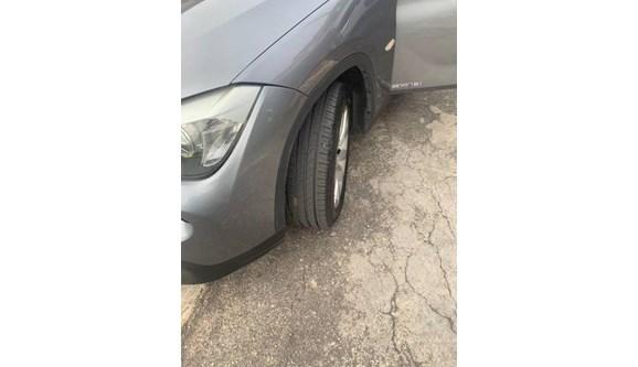 //www.autoline.com.br/carro/bmw/x1-20-18i-150cv-16v-gasolina-4p-automatico/2013/sao-paulo-sp/9373493