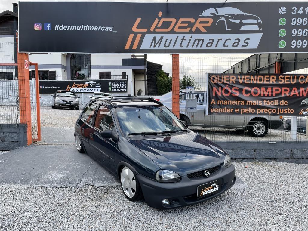 //www.autoline.com.br/carro/chevrolet/corsa-10-wind-champ-mpfi-60cv-2p-gasolina-manual/1998/criciuma-sc/13986035
