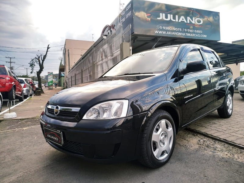 //www.autoline.com.br/carro/chevrolet/corsa-14-premium-8v-sedan-flex-4p-manual/2011/novo-hamburgo-rs/9369799