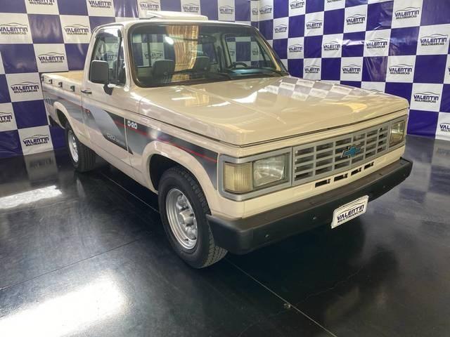 //www.autoline.com.br/carro/chevrolet/d-20-pick-up-40-custom-de-luxe-cabsimp-90cv-2p-diesel-manu/1991/blumenau-sc/12962791