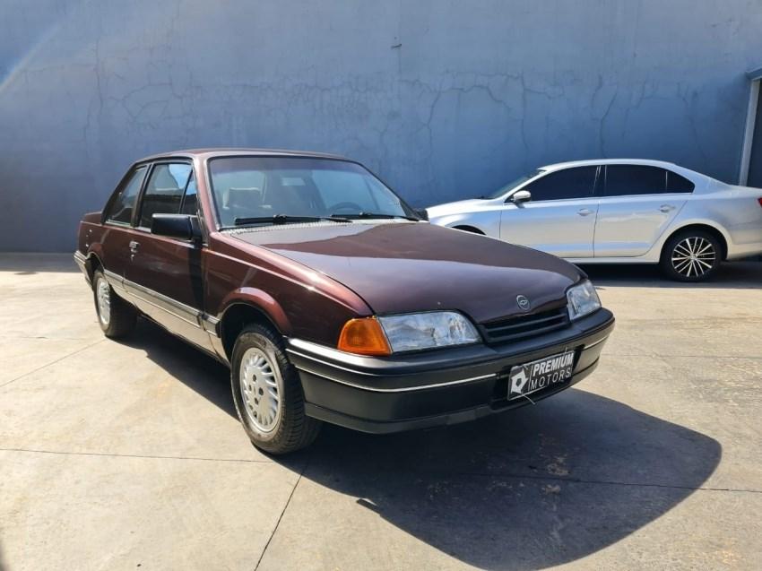 //www.autoline.com.br/carro/chevrolet/monza-20-sle-efi-110cv-2p-gasolina-manual/1991/campo-grande-ms/14730466