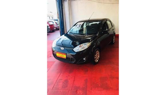 //www.autoline.com.br/carro/ford/fiesta-16-sedan-rocam-8v-flex-4p-manual/2013/sao-paulo-sp/12353925