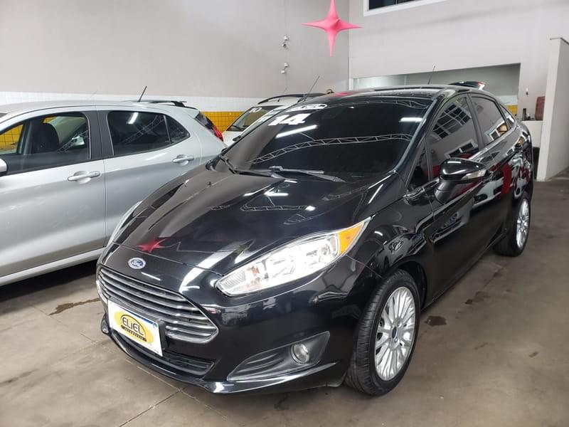 //www.autoline.com.br/carro/ford/fiesta-16-hatch-tivct-titanium-16v-flex-4p-manual/2014/volta-redonda-rj/12768673
