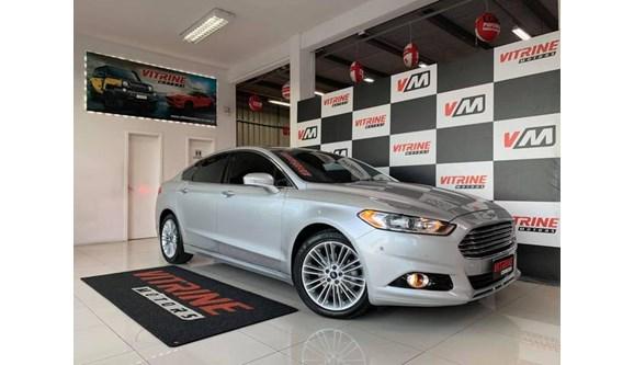 //www.autoline.com.br/carro/ford/fusion-20-titanium-16v-flex-4p-automatico/2013/estancia-velha-rs/11687339