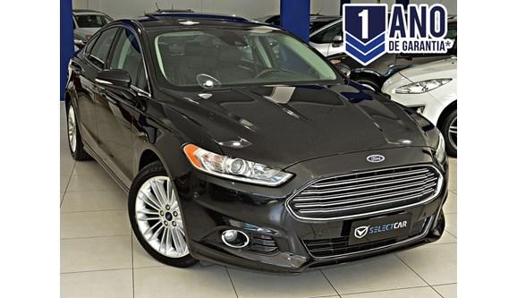 //www.autoline.com.br/carro/ford/fusion-20-titanium-16v-gasolina-4p-automatico/2014/novo-hamburgo-rs/7034946