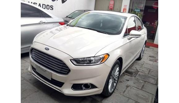 //www.autoline.com.br/carro/ford/fusion-20-titanium-hybrid-16v-flex-4p-automatico/2014/rio-grande-rs/8659413