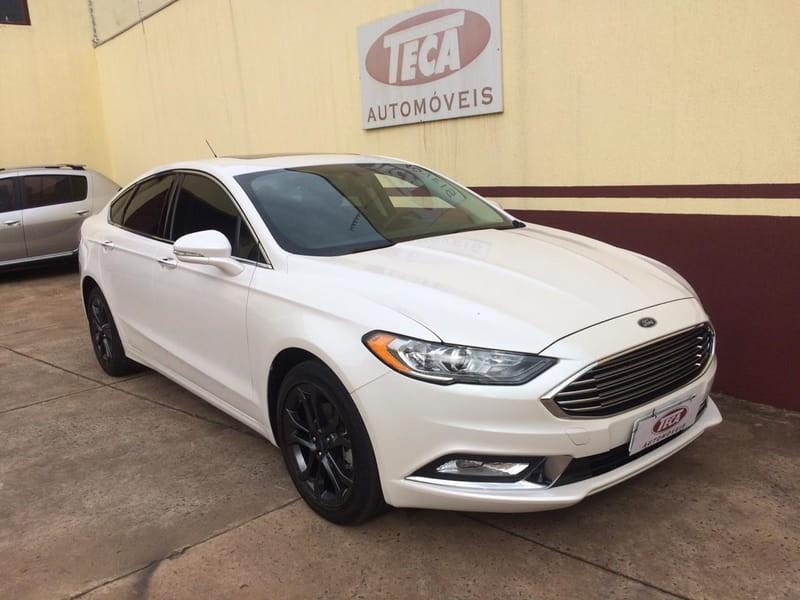 //www.autoline.com.br/carro/ford/fusion-20-sel-16v-gasolina-4p-automatico/2018/campo-grande-ms/9271600