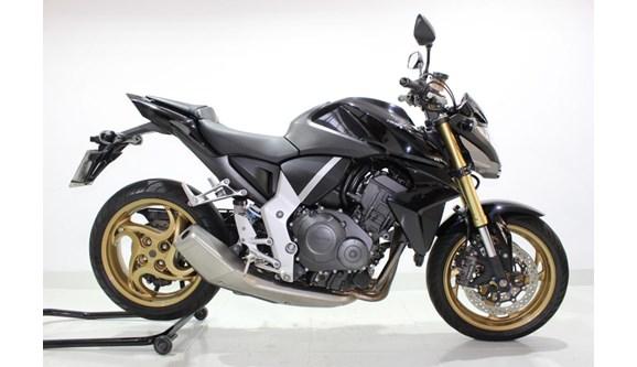//www.autoline.com.br/moto/honda/cb-1000-rstd-gas-mec-basico/2014/jundiai-sp/8334585