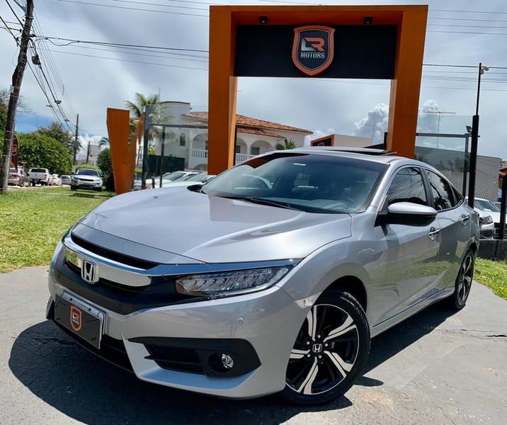 //www.autoline.com.br/carro/honda/civic-15-touring-16v-gasolina-4p-cvt/2017/goiania-go/11630436