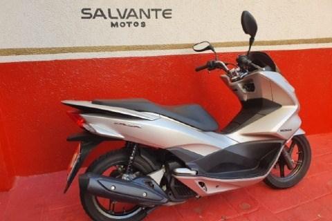 //www.autoline.com.br/moto/honda/pcx-150-dlx-gas-aut-basico/2018/sao-paulo-sp/13427343