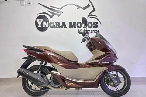 //www.autoline.com.br/moto/honda/pcx-150-dlx-gas-aut-basico/2018/sao-paulo-sp/14873904
