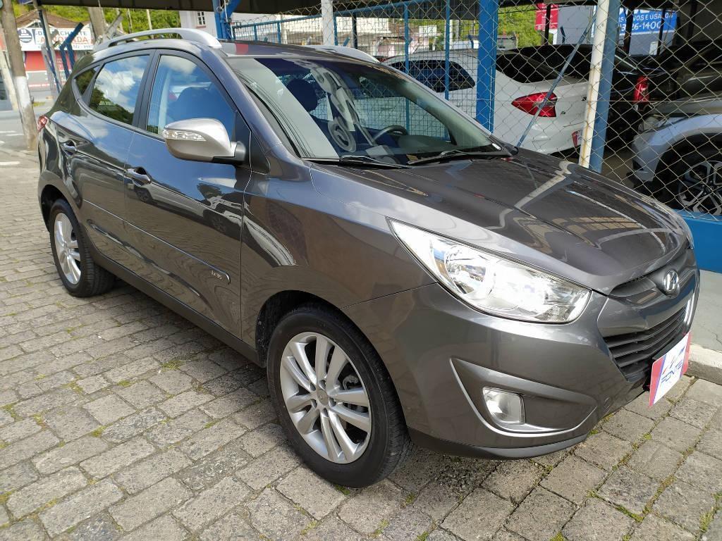 //www.autoline.com.br/carro/hyundai/ix35-20-16v-2wd-flex-4p-automatico/2015/blumenau-sc/13019965