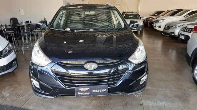 //www.autoline.com.br/carro/hyundai/ix35-20-16v-flex-4p-automatico/2014/araxa-mg/14579423
