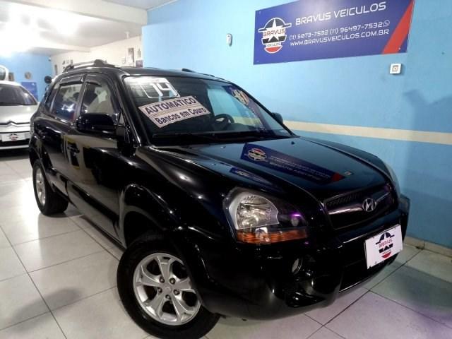 //www.autoline.com.br/carro/hyundai/tucson-20-gls-16v-flex-4p-automatico/2014/sao-paulo-sp/15253691