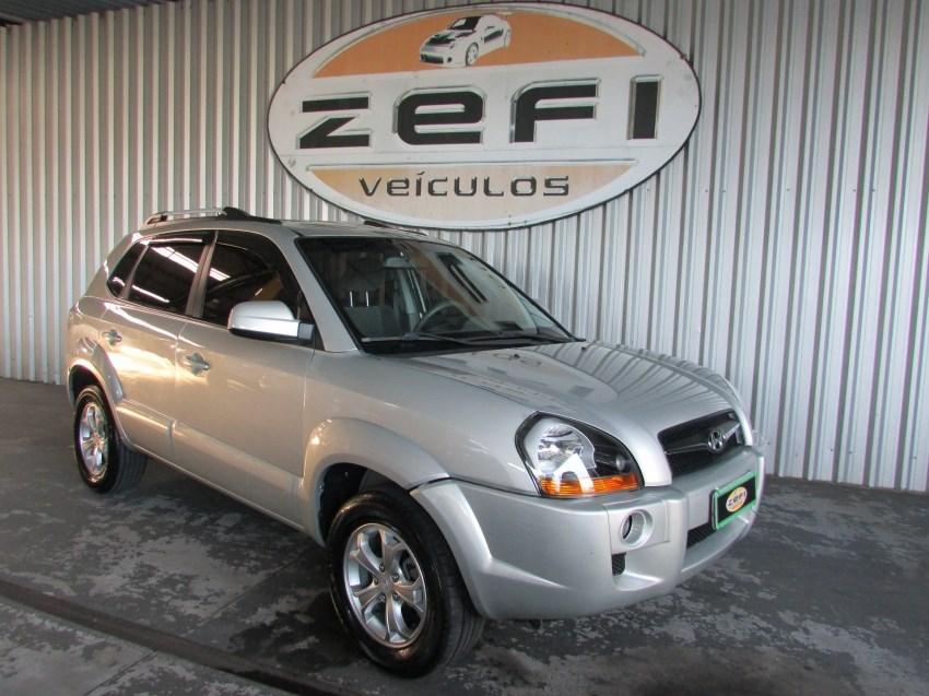 //www.autoline.com.br/carro/hyundai/tucson-20-gls-16v-gasolina-4p-automatico/2013/caxias-do-sul-rs/15279931