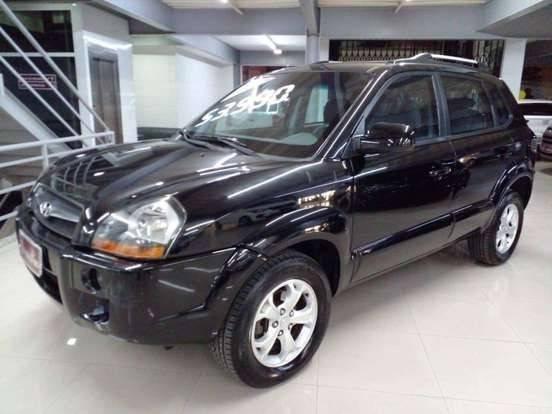 //www.autoline.com.br/carro/hyundai/tucson-20-gls-16v-flex-4p-automatico/2013/sao-paulo-sp/15774178