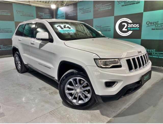 //www.autoline.com.br/carro/jeep/grand-cherokee-36-v6-laredo-24v-gasolina-4p-4x4-automatico/2014/sao-paulo-sp/14308028