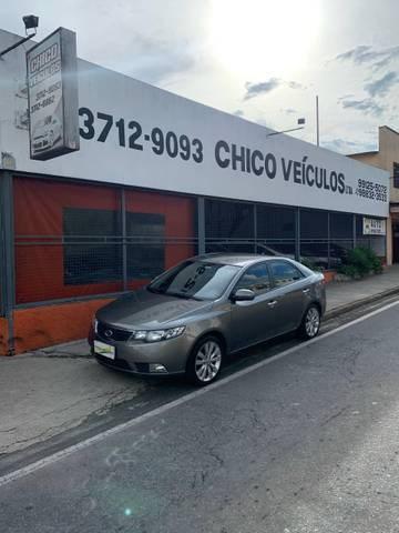 //www.autoline.com.br/carro/kia/cerato-16-sx-16v-sedan-gasolina-4p-automatico/2013/pocos-de-caldas-mg/13360412