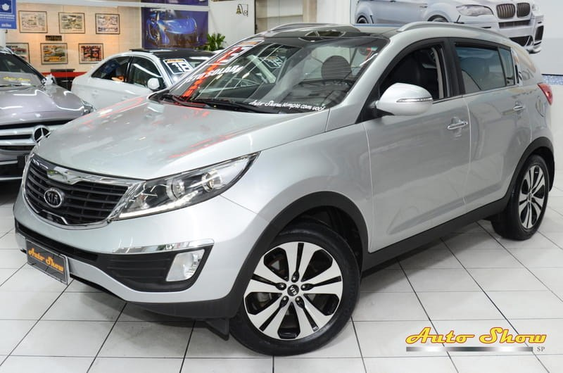 //www.autoline.com.br/carro/kia/sportage-20-ex-16v-flex-4p-automatico/2013/sao-paulo-sp/13259355