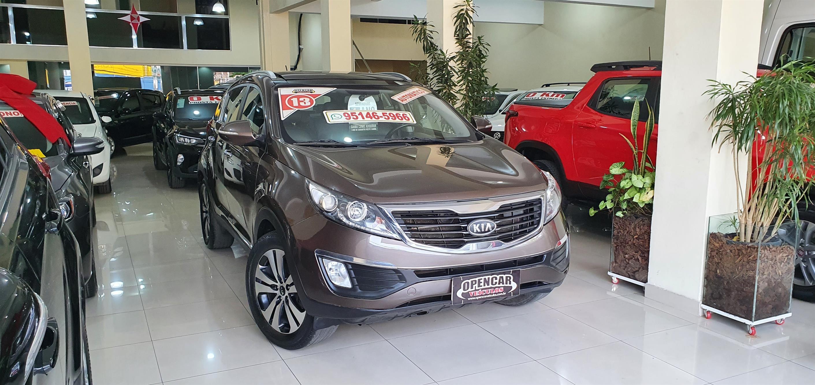 //www.autoline.com.br/carro/kia/sportage-20-ex-16v-flex-4p-automatico/2013/sao-paulo-sp/15492851