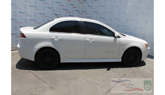 //www.autoline.com.br/carro/mitsubishi/lancer-20-gt-16v-160cv-4p-gasolina-automatico/2015/varzea-grande-mt/6788821