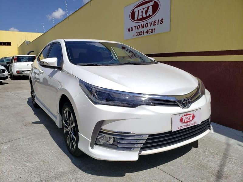 //www.autoline.com.br/carro/toyota/corolla-20-xrs-16v-flex-4p-automatico/2018/campo-grande-ms/11364944