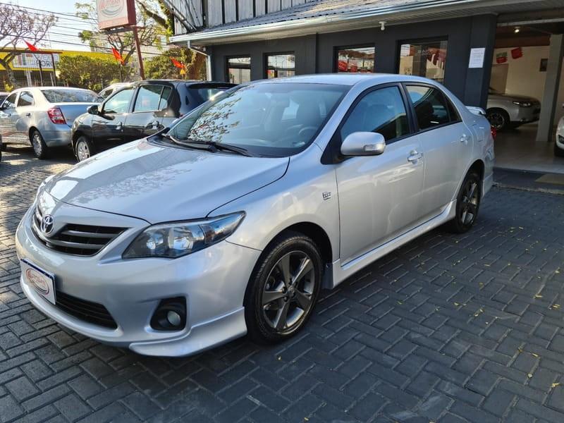 //www.autoline.com.br/carro/toyota/corolla-20-xrs-16v-flex-4p-automatico/2013/curitiba-pr/11865707