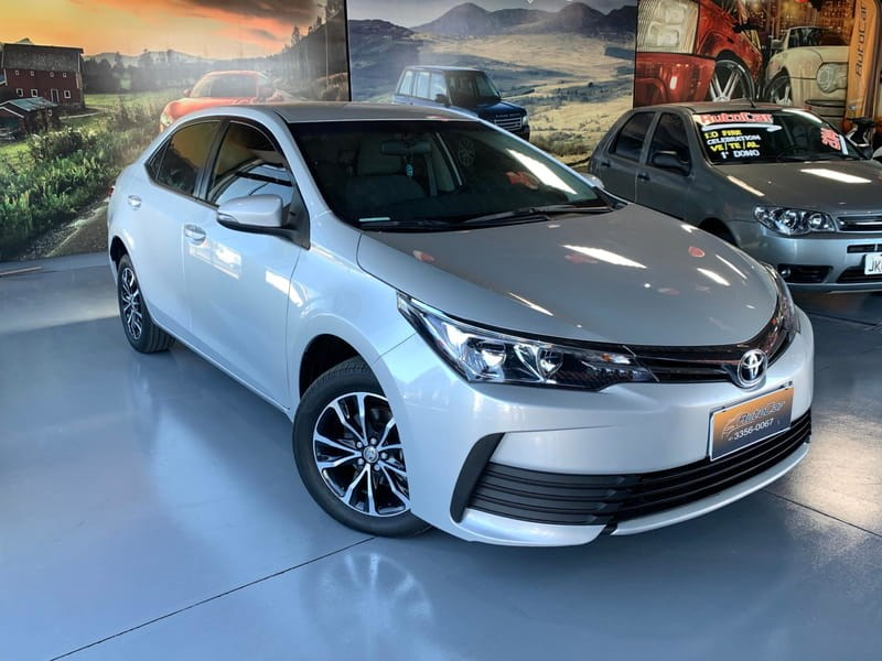 //www.autoline.com.br/carro/toyota/corolla-18-gli-16v-flex-4p-automatico/2018/brasilia-df/12376562