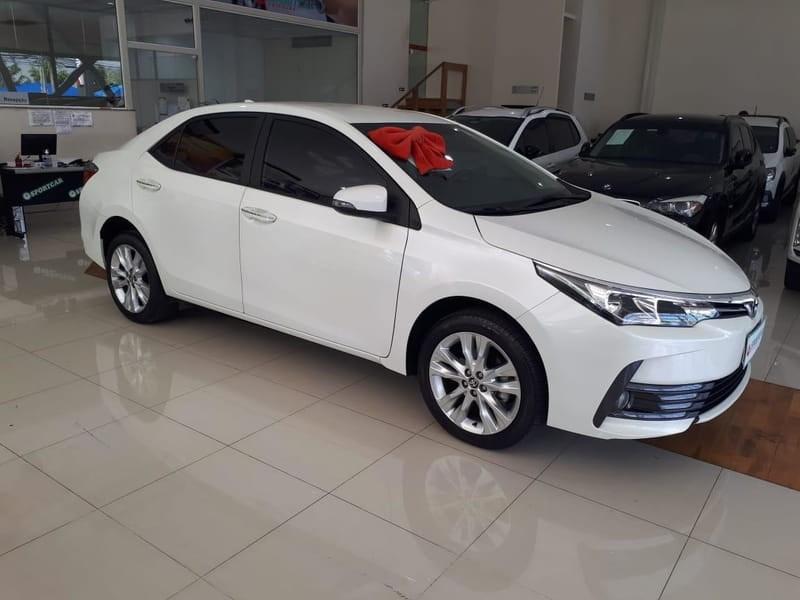 //www.autoline.com.br/carro/toyota/corolla-20-xei-16v-flex-4p-automatico/2018/campinas-sp/12583733