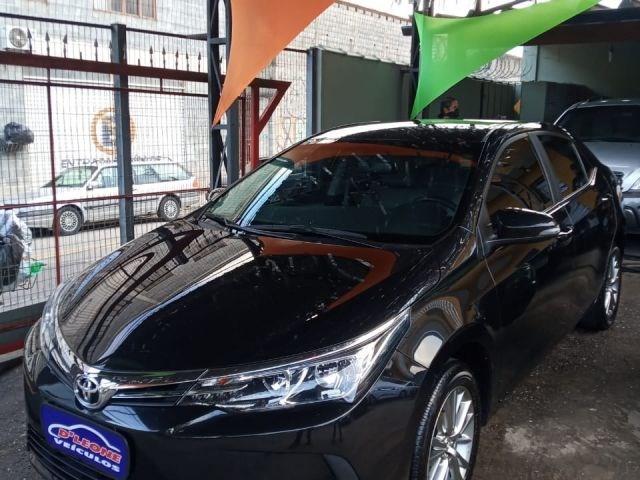 //www.autoline.com.br/carro/toyota/corolla-18-gli-upper-16v-flex-4p-automatico/2018/sao-paulo-sp/12955205