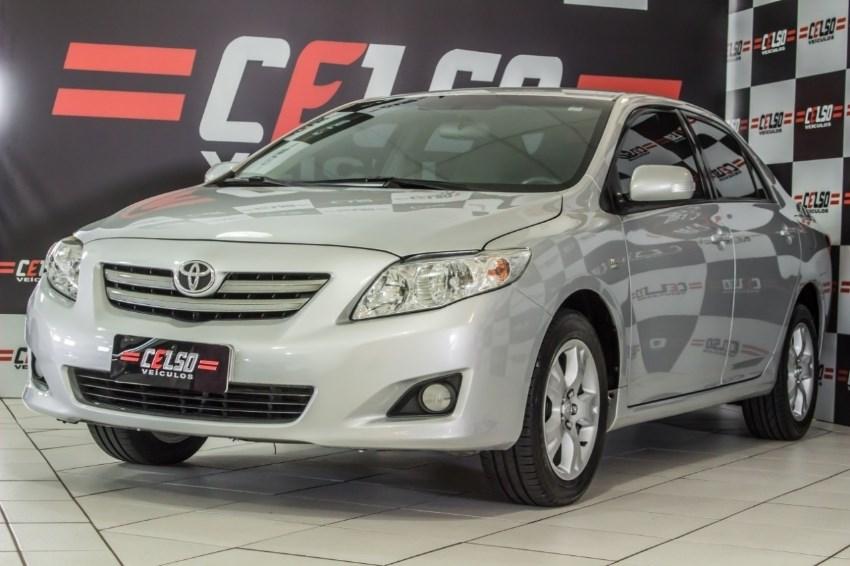 //www.autoline.com.br/carro/toyota/corolla-18-xli-16v-136cv-4p-gasolina-automatico/2009/dois-irmaos-rs/12964405