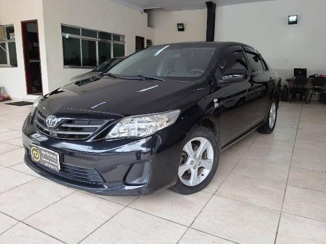 //www.autoline.com.br/carro/toyota/corolla-18-gli-16v-flex-4p-automatico/2014/juiz-de-fora-mg/13267507
