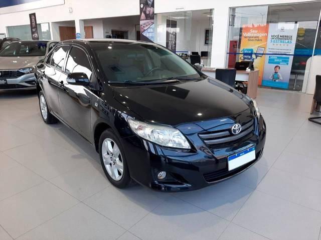 //www.autoline.com.br/carro/toyota/corolla-18-xei-16v-flex-4p-automatico/2010/tubarao-sc/13508798