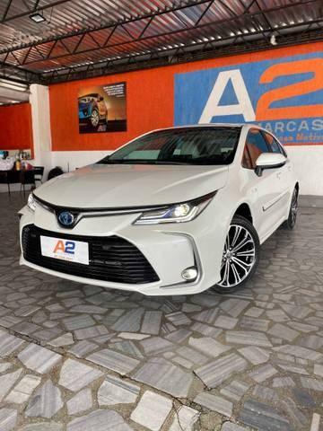 //www.autoline.com.br/carro/toyota/corolla-18-altis-hybrid-premium-16v-flex-4p-cvt/2021/natal-rn/13935588