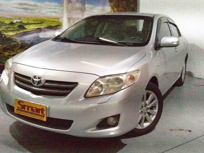//www.autoline.com.br/carro/toyota/corolla-18-seg-16v-flex-4p-automatico/2009/sorocaba-sp/14296138