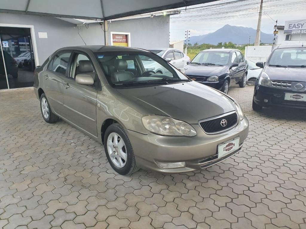 //www.autoline.com.br/carro/toyota/corolla-18-seg-16v-gasolina-4p-automatico/2004/palhoca-sc/14454709