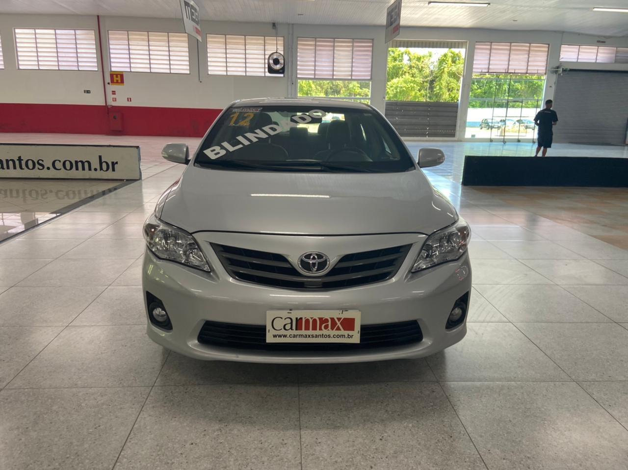 //www.autoline.com.br/carro/toyota/corolla-20-xei-16v-flex-4p-automatico/2012/santos-sp/14515743