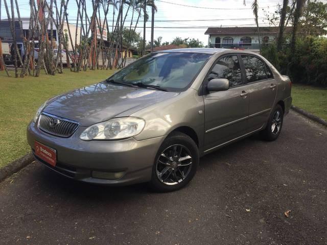 //www.autoline.com.br/carro/toyota/corolla-18-xei-16v-gasolina-4p-automatico/2003/joinville-sc/14589141