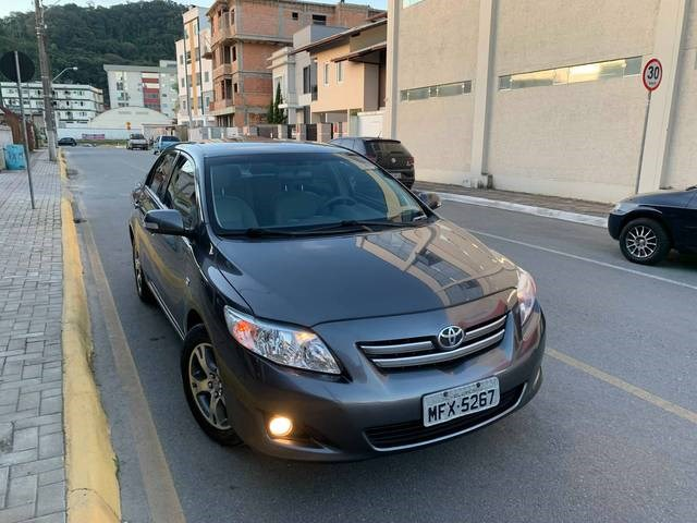 //www.autoline.com.br/carro/toyota/corolla-18-xei-16v-flex-4p-automatico/2010/guaramirim-sc/14622368