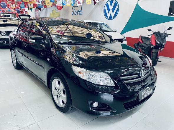 //www.autoline.com.br/carro/toyota/corolla-18-xei-16v-flex-4p-automatico/2009/sao-paulo-sp/14652766