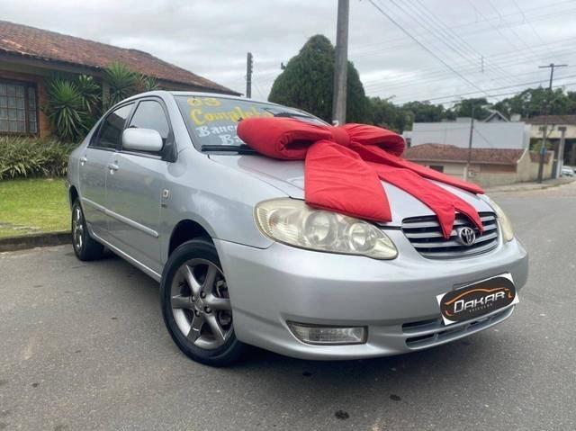 //www.autoline.com.br/carro/toyota/corolla-18-xei-16v-gasolina-4p-manual/2003/joinville-sc/14971424
