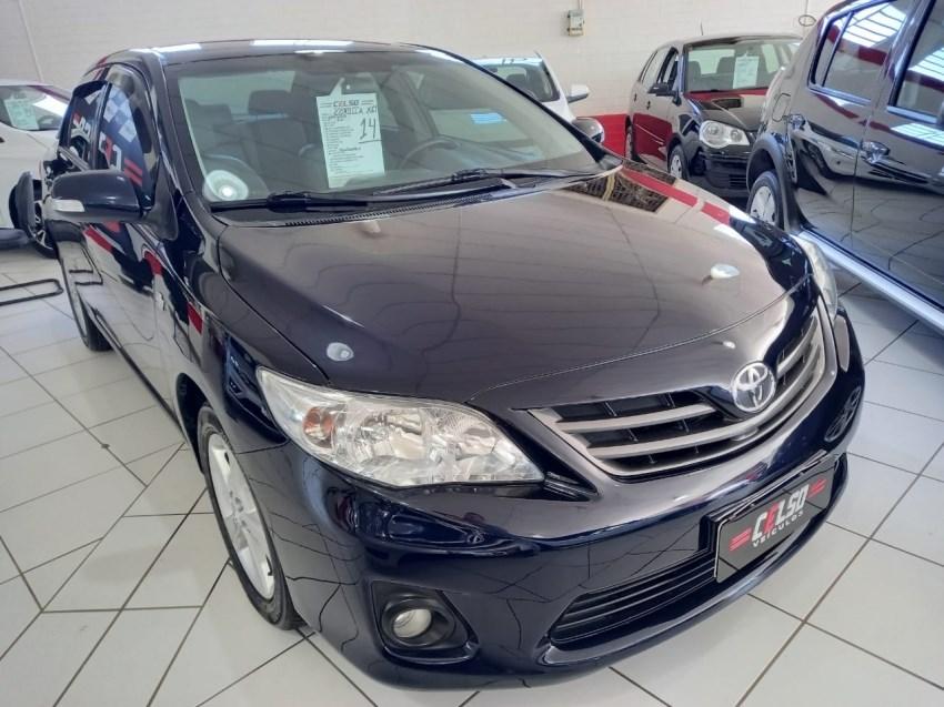 //www.autoline.com.br/carro/toyota/corolla-20-xei-16v-flex-4p-automatico/2014/dois-irmaos-rs/15087401