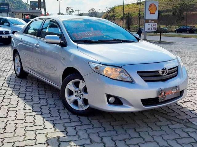 //www.autoline.com.br/carro/toyota/corolla-18-xei-16v-flex-4p-automatico/2009/juiz-de-fora-mg/15092853