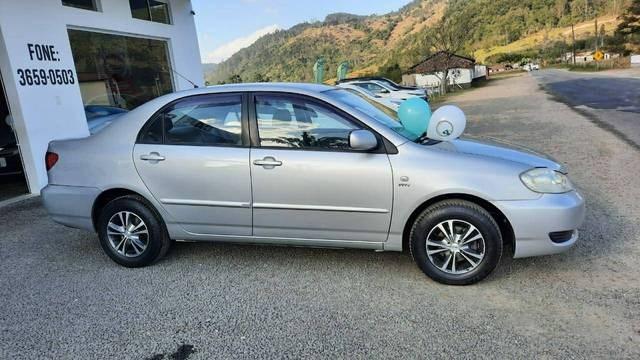 //www.autoline.com.br/carro/toyota/corolla-16-xli-16v-gasolina-4p-automatico/2006/pedras-grandes-sc/15113656