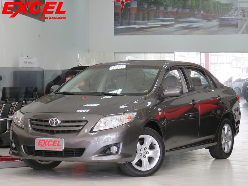 //www.autoline.com.br/carro/toyota/corolla-18-gli-16v-flex-4p-automatico/2011/curitiba-pr/9165288