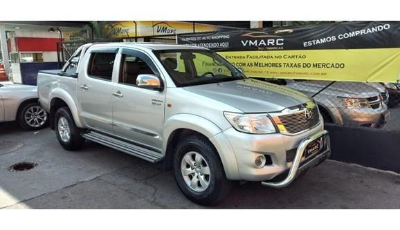 //www.autoline.com.br/carro/toyota/hilux-27-sr-16v-picape-flex-4p-automatico/2013/sao-paulo-sp/11186308