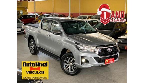 //www.autoline.com.br/carro/toyota/hilux-27-sr-16v-picape-flex-4p-automatico/2020/salvador-ba/13255345