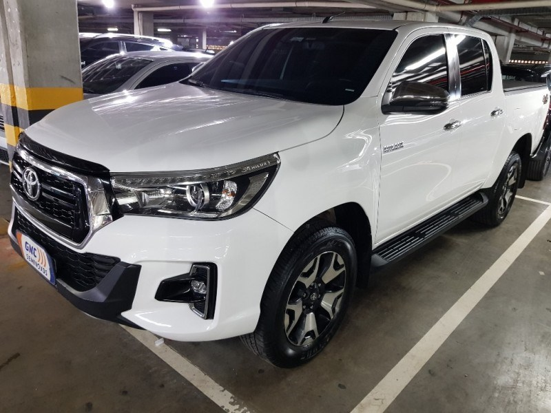 //www.autoline.com.br/carro/toyota/hilux-28-cd-srx-16v-diesel-4p-4x4-turbo-automatico/2019/salvador-ba/15735471
