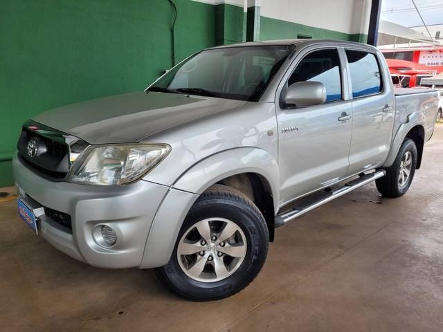 //www.autoline.com.br/carro/toyota/hilux-27-cd-sr-16v-gasolina-4p-manual/2009/brasilia-df/15860824